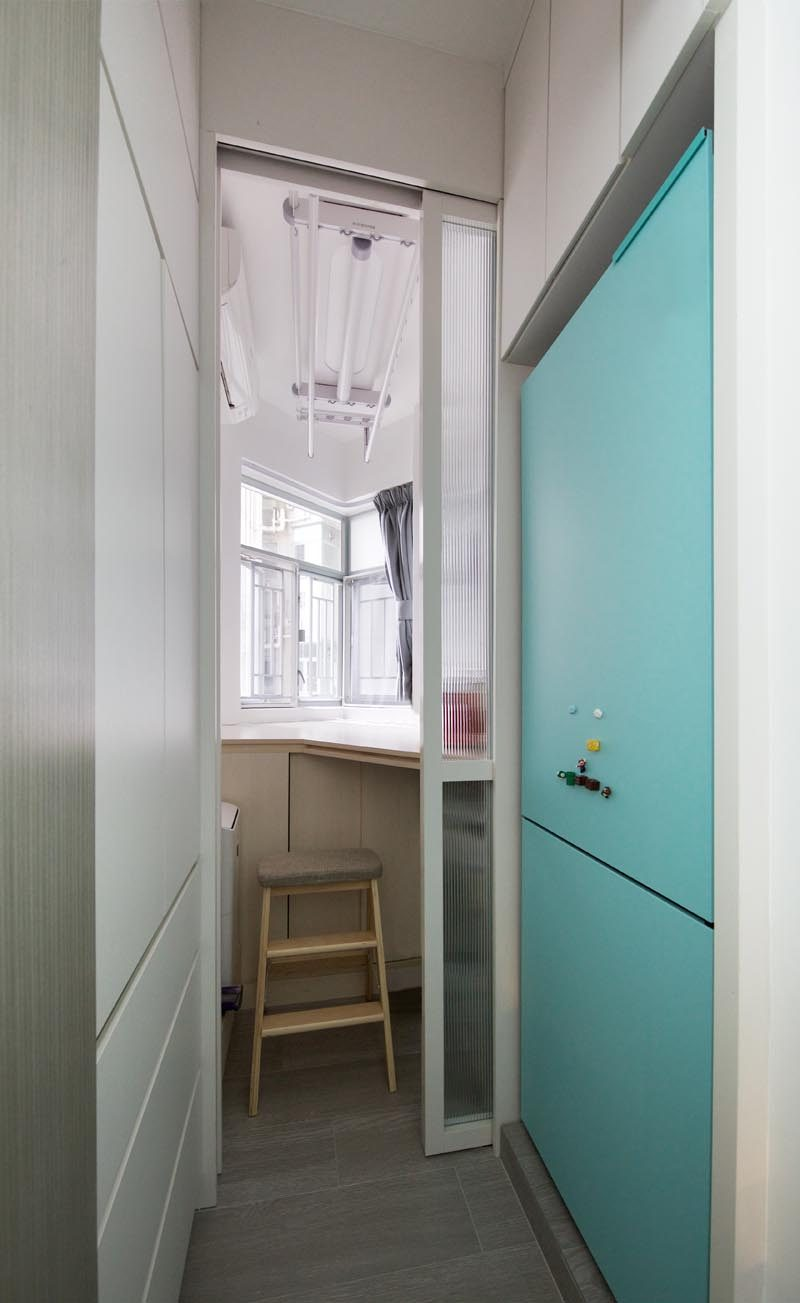 This small apartment has a pocket door that opens to reveal a guest room with storage space. #PocketDoor #SmallApartment