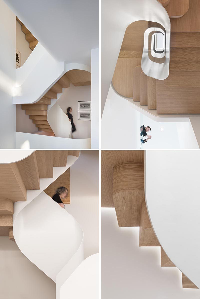 Wood stairs spiral their way between the floors of this house, adding a sculptural element to the home. #WoodStairs #ModernStairs #SpiralStairs