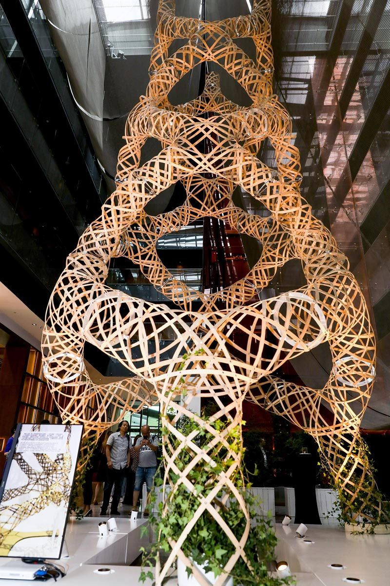 "AntiStatics Architecture has designed a bamboo tower installation called ""Woven Grove"", that was exhibited at Design China Beijing 2019. #ModernSculpture #BambooSculpture #ArtInstallation"