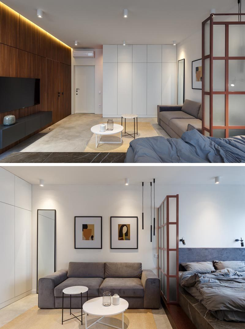 Stepping inside this small apartment, you are greeted by the living area and a large wood accent wall with hidden lighting and a smaller white wall with plenty of storage.