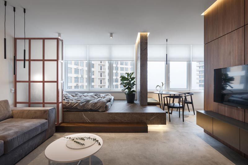 SVOYA studio has recently completed the modern interior of a small 400 square foot (39m2) apartment, that features a bed raised on a platform. #SmallApartment #PlatformBed #InteriorDesign #OpenBedroom