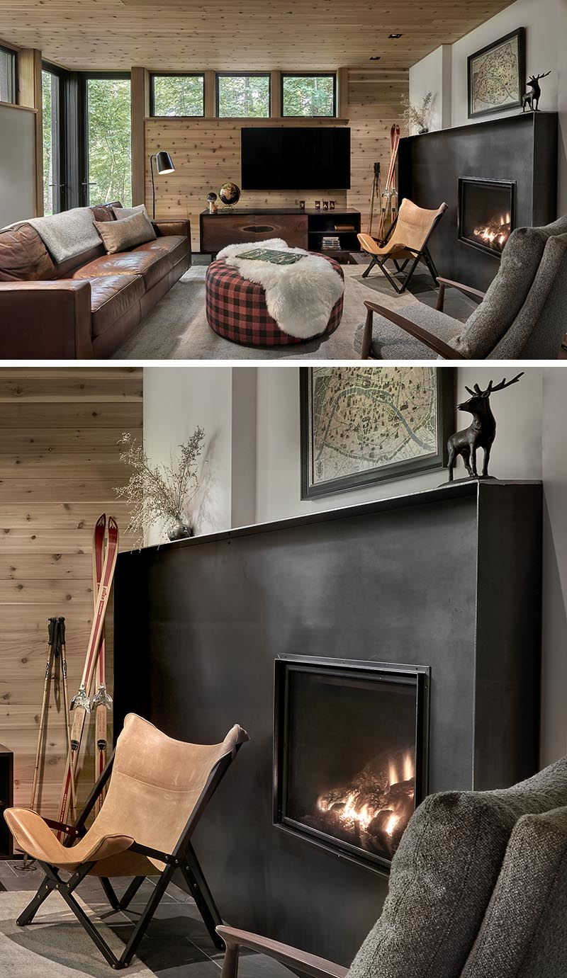 A hand-worked blackened steel fireplace surround commands attention in this cozy living room. #SteelFireplaceSurround #BlackSteelFireplace #FireplaceDesign #FireplaceSurround