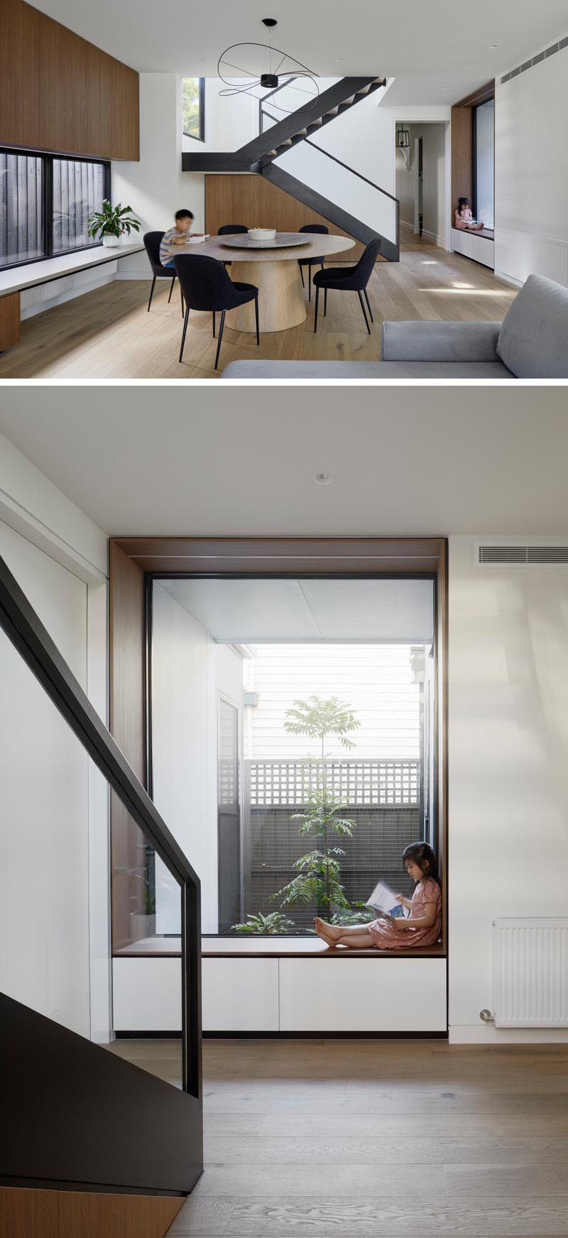 Adjacent to the living room in this modern house is an open dining room with a round table and minimalist sculptural pendant light. Steel stairs lead up to the new second floor, while at the bottom of the stairs, there's a built-in wood-lined window seat that looks out to a small garden at the side of the home. #ModernDiningRoom #WindowSeat #BuiltInWindowSeat