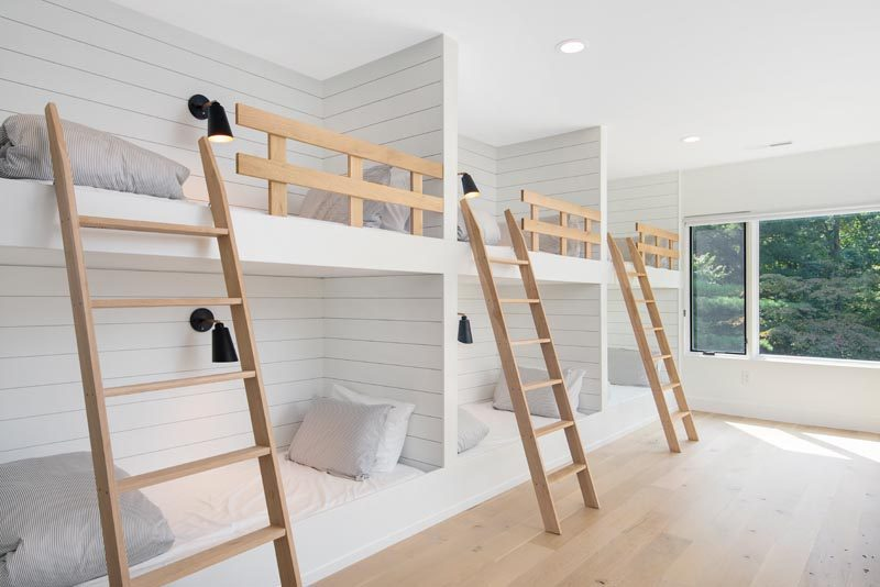 A Wall Of Built-In Bunk Beds Creates Plenty Of Sleeping Space For Visitors