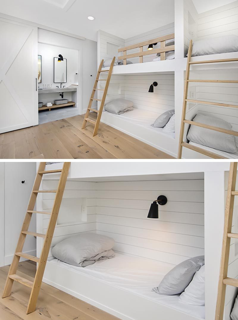 In this modern bedroom, three sets of built-in bunk beds with wood ladders and safety rails, create a place for six people to sleep. Each bunk has a niche, outlets and an individual switch for their separate light. #Bedroom #BunkBeds #MultipleBunkBeds #ModernBedroom