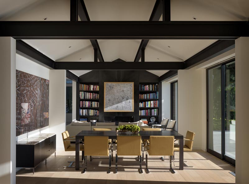 Heavily articulated log and timber columns and beams were removed and  replaced with a thin steel framework, opening up the space both  physically and visually.  #Architecture #InteriorDesign #ModernHouse