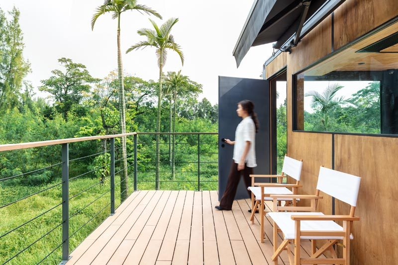 This simple balcony has wood decking and a simple wood and steel railing. #Balcony