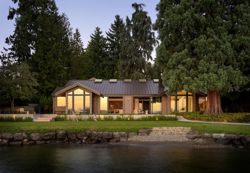 "Architecture firm Olson Kundig, has designed the remodel of a dated ""log cabin"" inspired ranch house, and created an open, flexible and view-oriented home for an active young family. #ModernHouse #ModernRanchHouse #Architecture #LakeHouse"