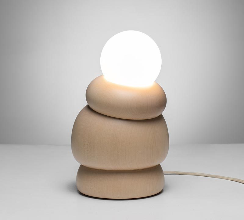Studio Sain has collaborated with woodturner Hermann Viehhauser to create Bulbous, a collection of modern home decor items that include a shelf, a mirror, a hanging lamp, and a table lamp, some with movable parts. #Design #LightingDesign #WoodDecor #WoodLighting #ModernDecor