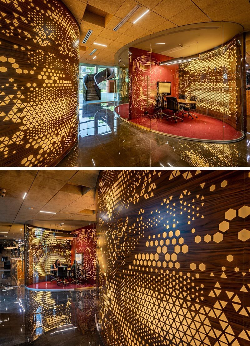 The random assortment of patterns and shapes in these curved walls are highlighted by the use of integrated lighting that's hidden behind Plexiglass. #PerforatedWalls #Patterns #WorkplaceDesign #OfficeDesign #Lighting