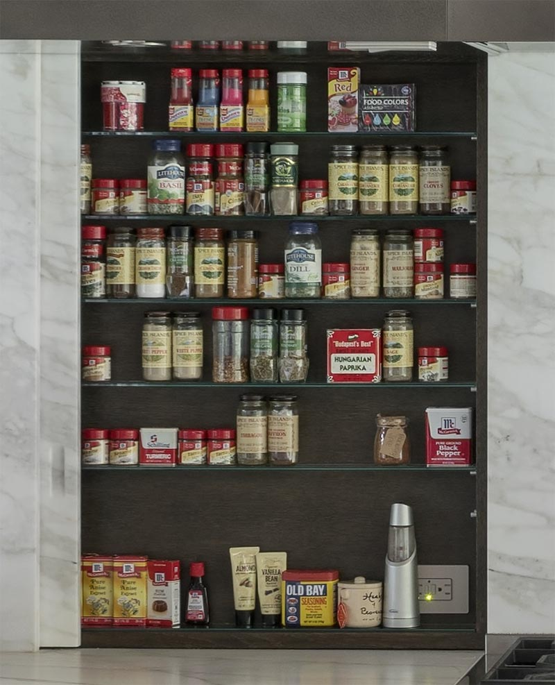Kitchen Design Idea - Spice racks and shelves are often overlooked, however in this kitchen there are two sliding panels neatly disguised on either side of the stove, adding storage and keeping the spices within reach. #SpiceRack #SpiceShelf #HiddenSpiceRack #HiddenStorage #KitchenDesign
