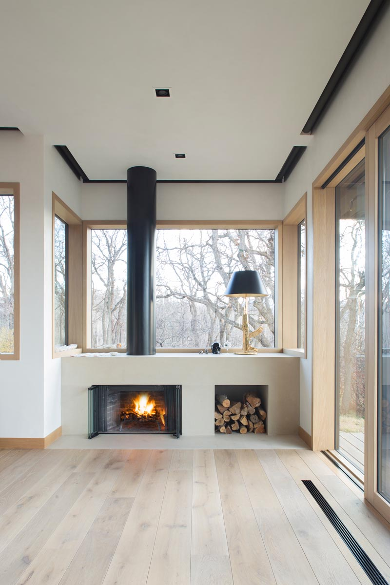 This modern master suite has a fireplace and blackout blinds that are recessed into the ceiling. #BlackoutBlinds #Fireplace