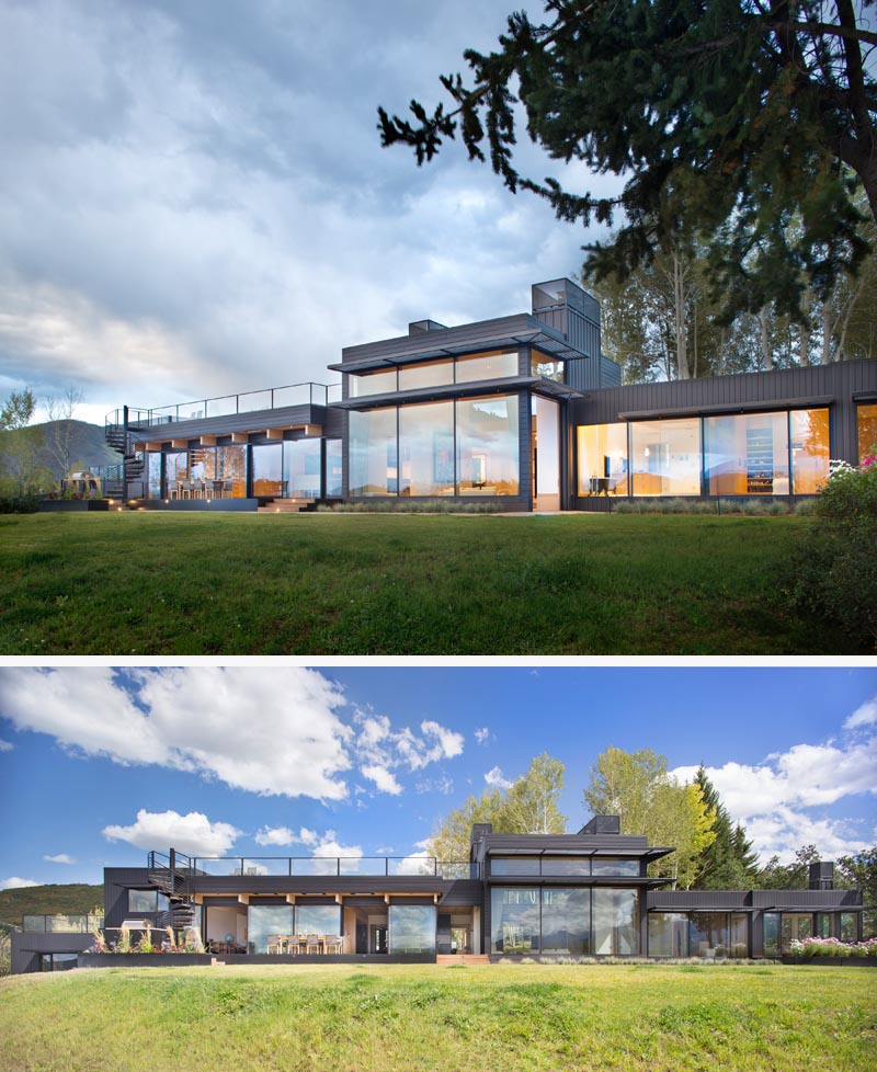 The entire length of this modern house has been designed with an abundance of windows. Spiral stairs at one end lead up to a rooftop deck. #ModernHouse #HouseDesign #ModernArchitecture