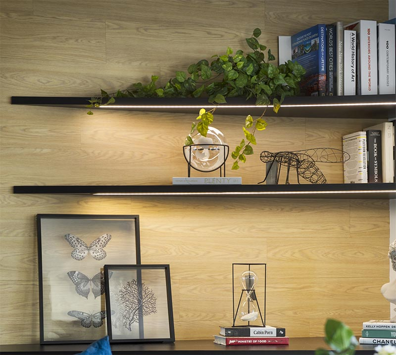 In this modern living room, the corner has been adorned with a pair of shelves that keeps the corner bright and highlights the displayed items. #CornerShelves #CornerShelf #Lighting #ModernLivingRoom