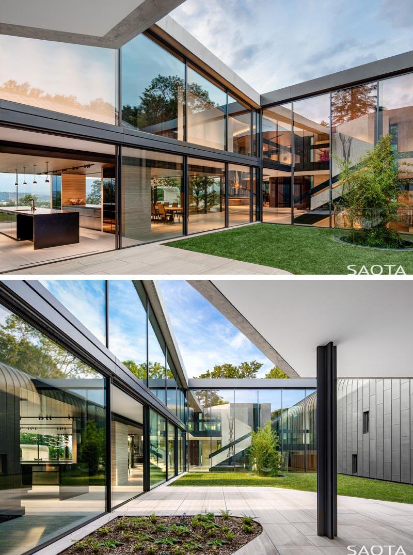 Sliding glass doors open up this modern kitchen to an internal open-air courtyard. #Courtyard #GlassWalls