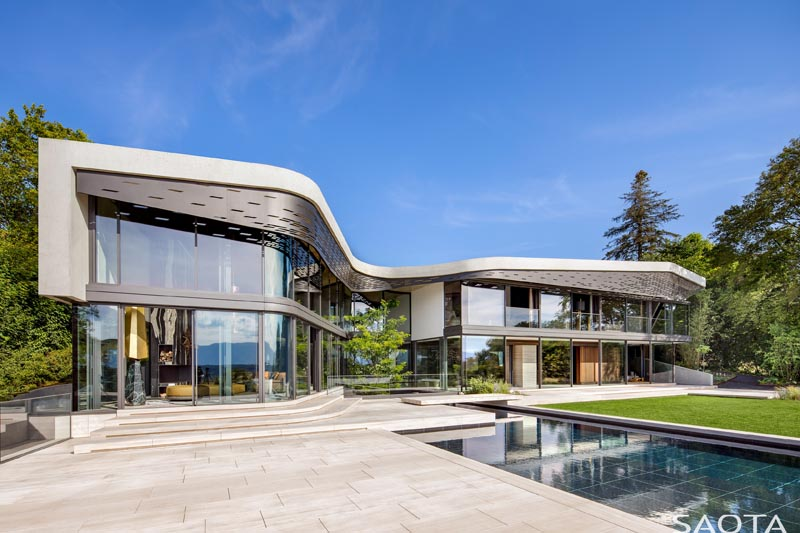 Architecture firm SAOTA has designed Villa Courbe, a modern Swiss house on a slope that overlooks Lac Léman. #ModernHouse #HouseDesign #ModernArchitecture