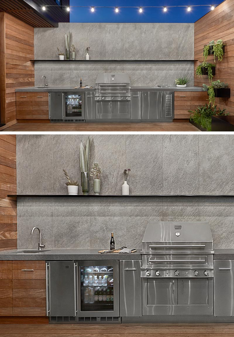 This modern wall-to-wall outdoor kitchen features stainless steel cabinets, and custom wood cabinets designed by dSPACE with Ipe wood panels and a concealed stainless steel support frame. #OutdoorKitchen #StainlessSteelKitchen