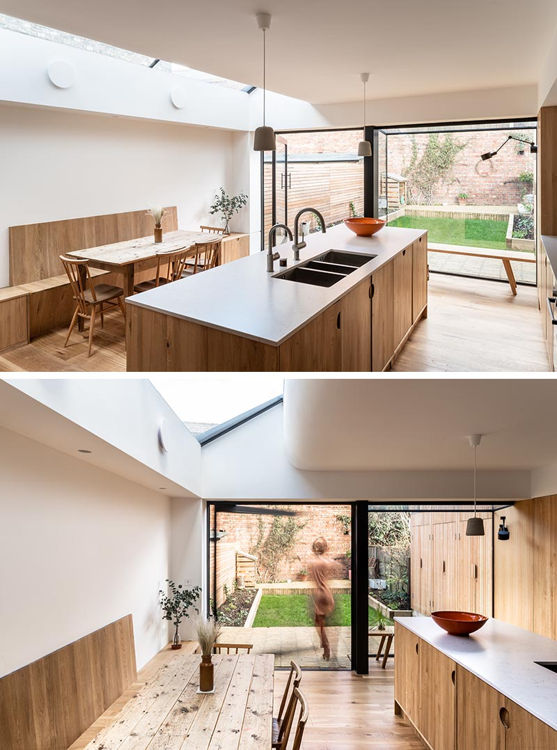 Kitchen Ideas - To stay within their budget, the designers created a kitchen using standard off-the-shelf kitchen units, but they had bespoke natural oak fronts and facing dividers made that included small cut-out finger pulls instead of hardware. #ModernWoodKitchen #HardwareFreeKitchen #KitchenDesign #OakCabinets