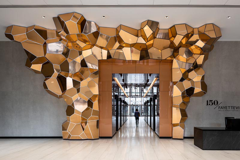 A Crystalline Inspired Sculpture Creates A Focal Point In This Office Lobby