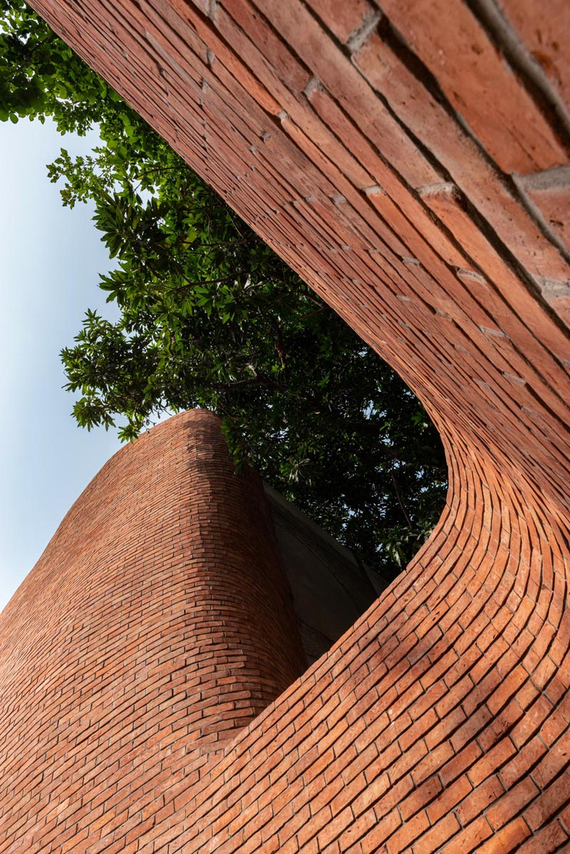 Architectural studio Saransh has designed the KBM Sweet Shop in Ahmedabad, India, that showcases a brick facade with softened edges. #Brick #ModernArchitecture #BuildingDesign