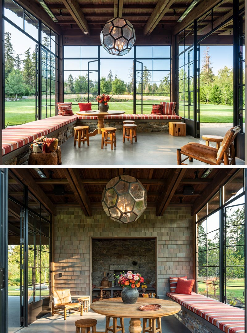 This sun room has plenty of windows looking out onto the field, as well as wrap-around seating and an inglenook.
