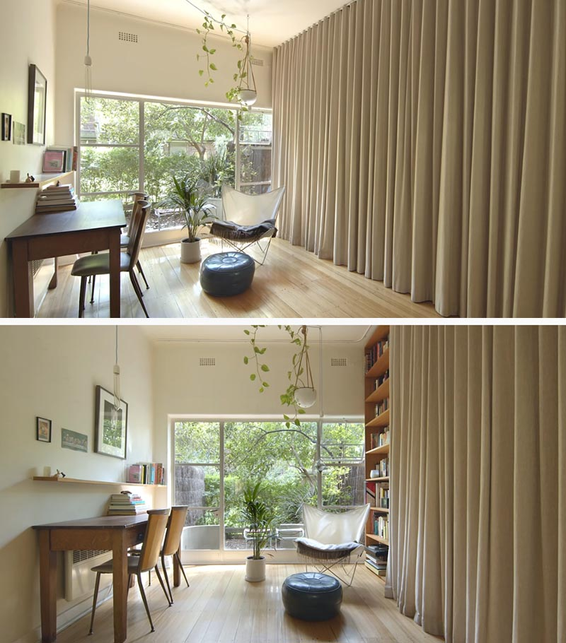 A Floor-To-Ceiling Curtain Hides A Wall