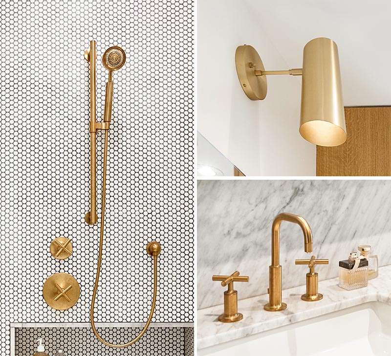 The brass fixtures throughout this modern bathroom, like in the shower, the lighting and faucets, add a metallic touch of glamor. #BrassBathroomFixtures #BrassFixtures #ModernBathroom