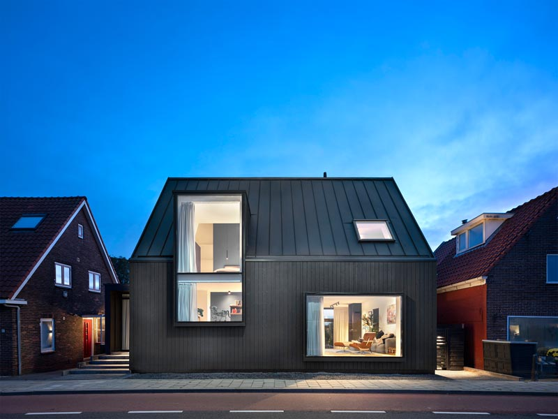 This Modern Black House In The Netherlands Has Large Windows Facing The Street