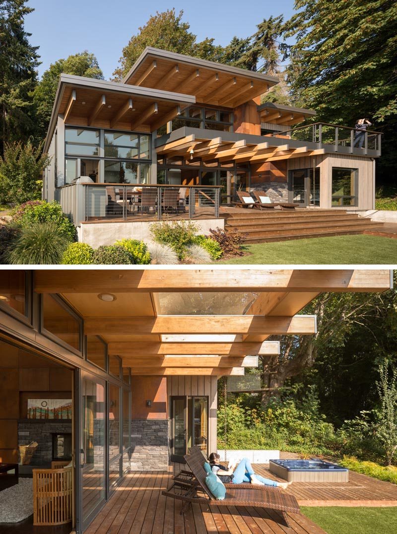 The social areas of this Pacific-Northwest house open up to a deck with an outdoor dining space and hot tub.  #ModernArchitecture #PacificNorthwestArchitecture #OutdoorSpace