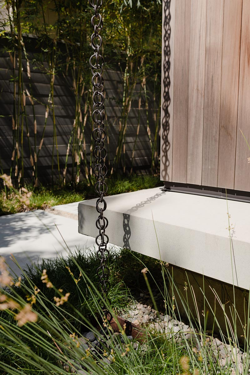 Modern Rain chains are a great way to add a unique design detail to your home as they help direct water away from the foundation of your home, preventing it from weakening over time.  #RainChain #Architecture #ModernRainChain #RainChainIdeas