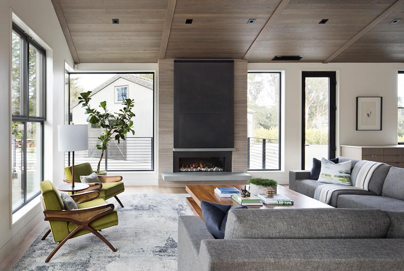 A linear fireplace with a steel surround and a cantilevered hearth.