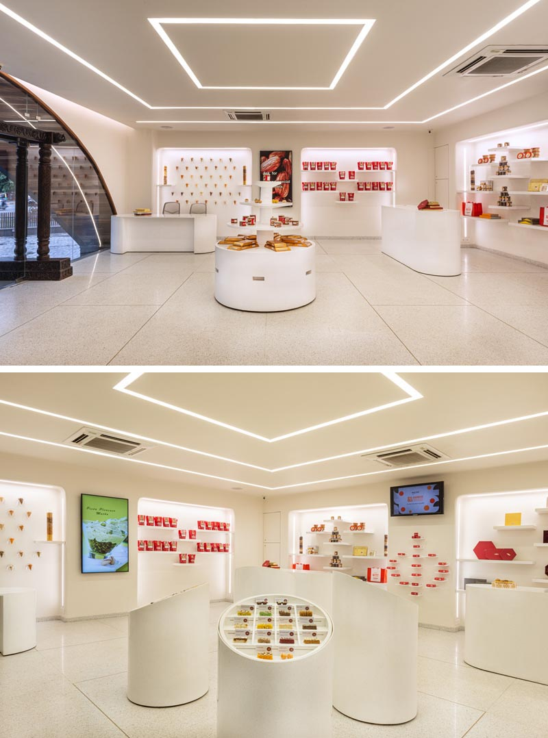 The interior of this candy store has been envisaged as a 'gallery' for sweets, intending to act as a neutral backdrop to an inventory that's vibrant and colorful, allowing the products to stand out. #RetailStore #StoreDesign #RetailDesign