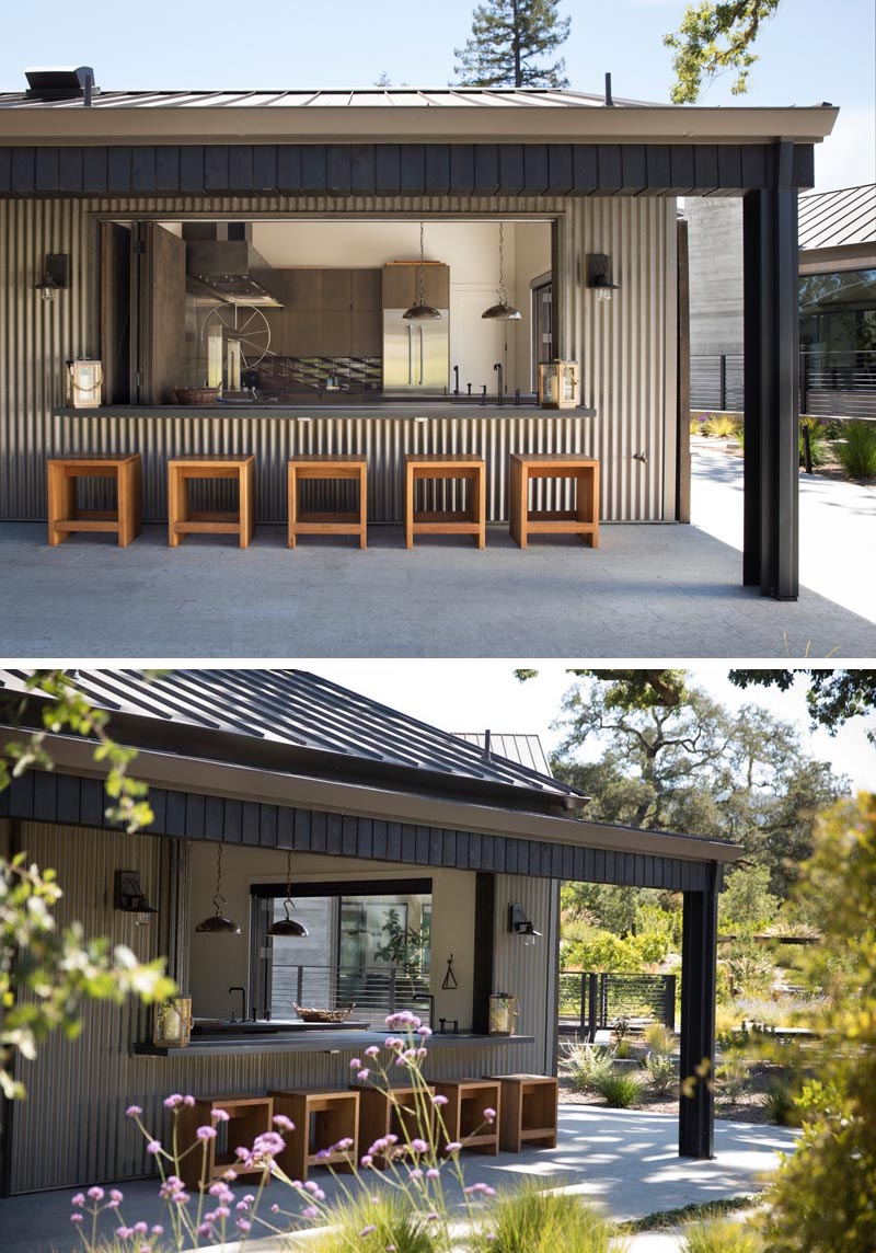 A custom outdoor kitchen with bar seating and patio.