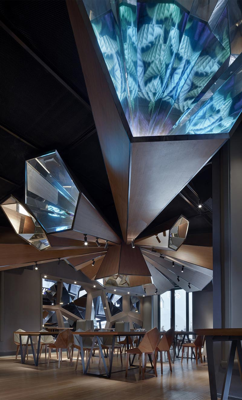 A modern restaurant with ceiling accent. #ModernRestaurant