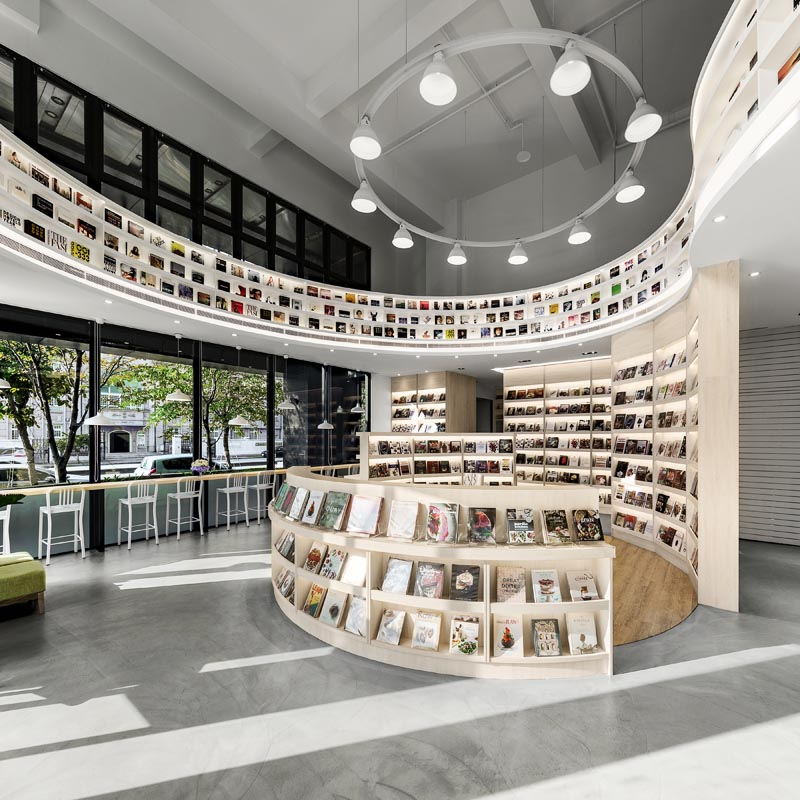 A modern library with circular shelving. #LibraryDesign