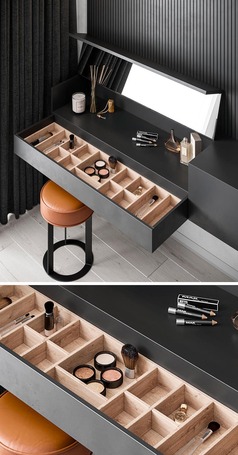 The Interior Workshop by Iryna Lysiuk has designed a master bedroom that features a minimalist black floating sideboard with a hidden make-up vanity. #HiddenMakeupVanity #MakeupVanity #BedroomDesign #FurnitureDesign