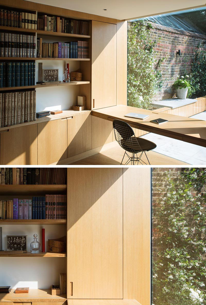 The modern home office desk is positioned to take advantage of the garden view through the large picture window. #HomeOffice #Shelving #Desk #PictureWindow