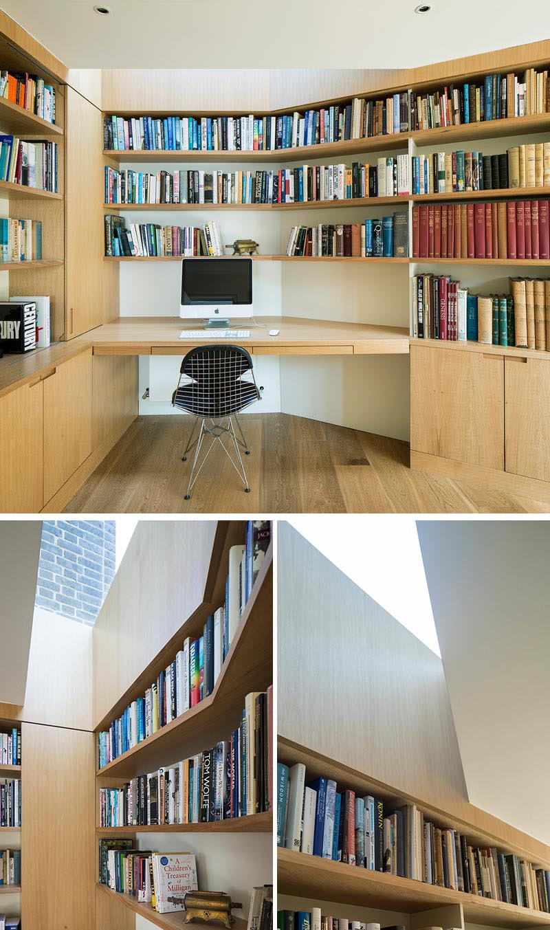 Inside this modern home office, bespoke joinery and desks are carefully integrated into the design of the extension, providing a home for an extensive collection of artifacts and books collected over the years. A skylight helps provide natural light to the first desk area. #HomeOffice #Desk #Bookshelves #Skylight