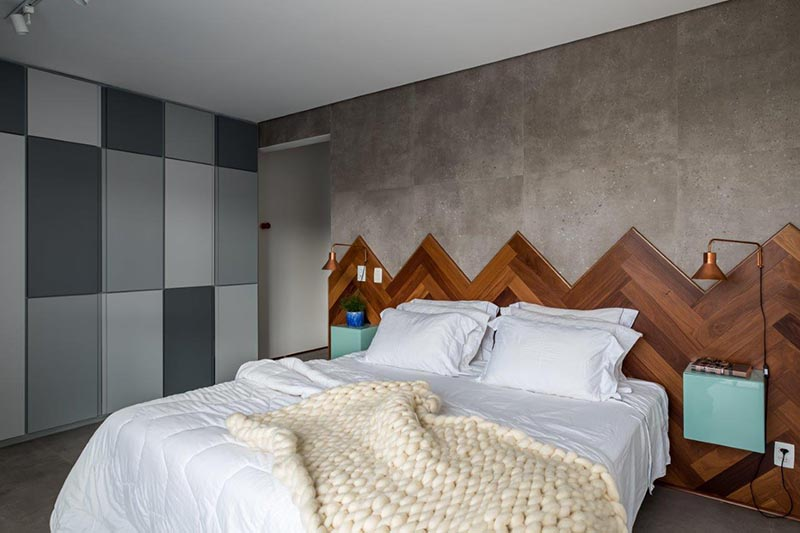 A Wood Headboard In A Herringbone Pattern Adds A Creative Touch In This Bedroom