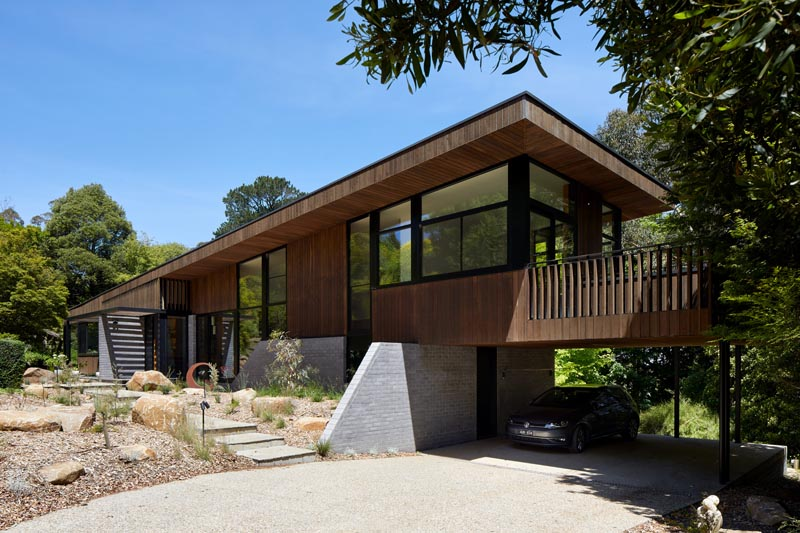 BENT Architecture has designed a split-level house in Melbourne, Australia, that has an angled roof, and uses locally-sourced Ironbark and Timbercrete blockwork. #ModernHouse #ModernArchitecture #Timbercrete #AngledRoof