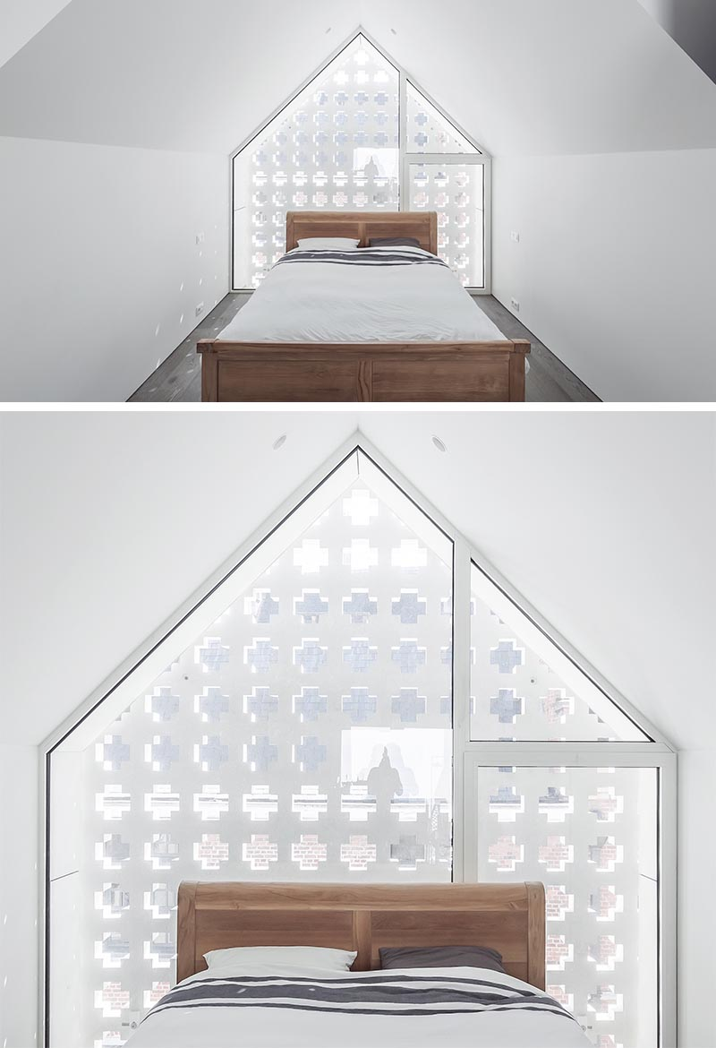 A cross pattern facade allows the natural light to travel through, but at the same time provides privacy from people passing by. #Architecture #Windows #PatternedFacade