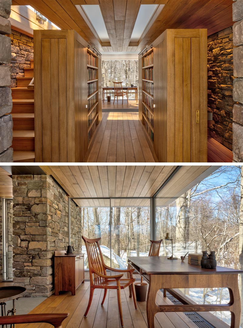 The glass-enclosed writer's space which is cantilevered over the hill, has uninterrupted views along a 16-foot window wall. #WritersCabin #Cabin #Studio #GlassWalls