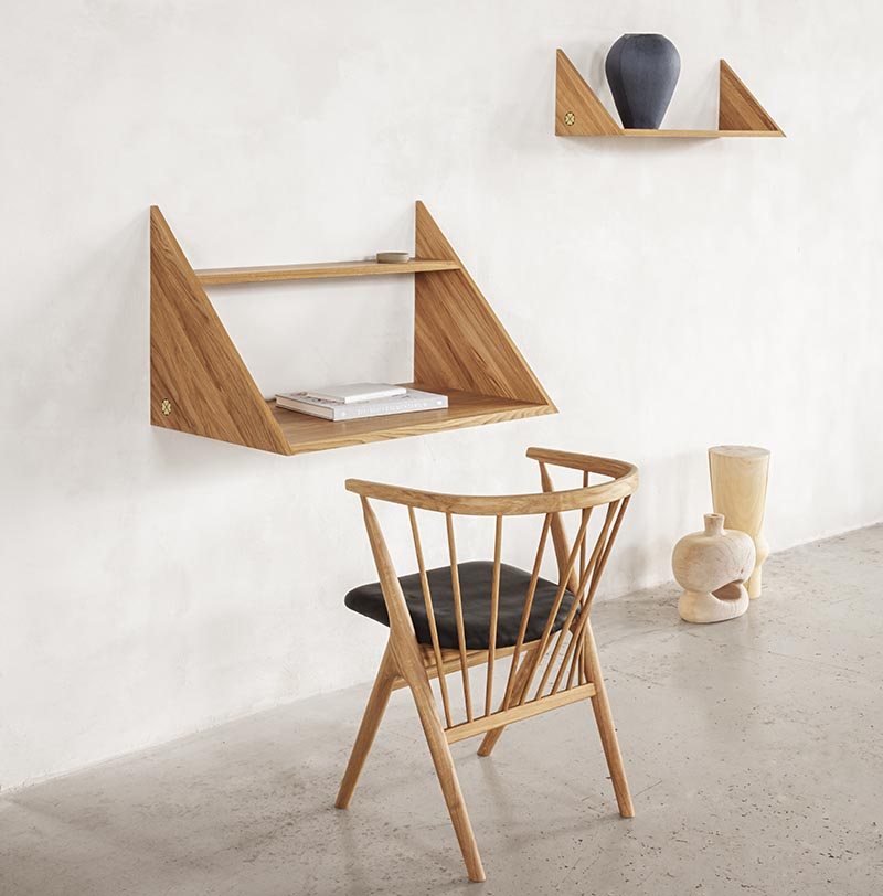 A modern floating wall desk with matching shelf.