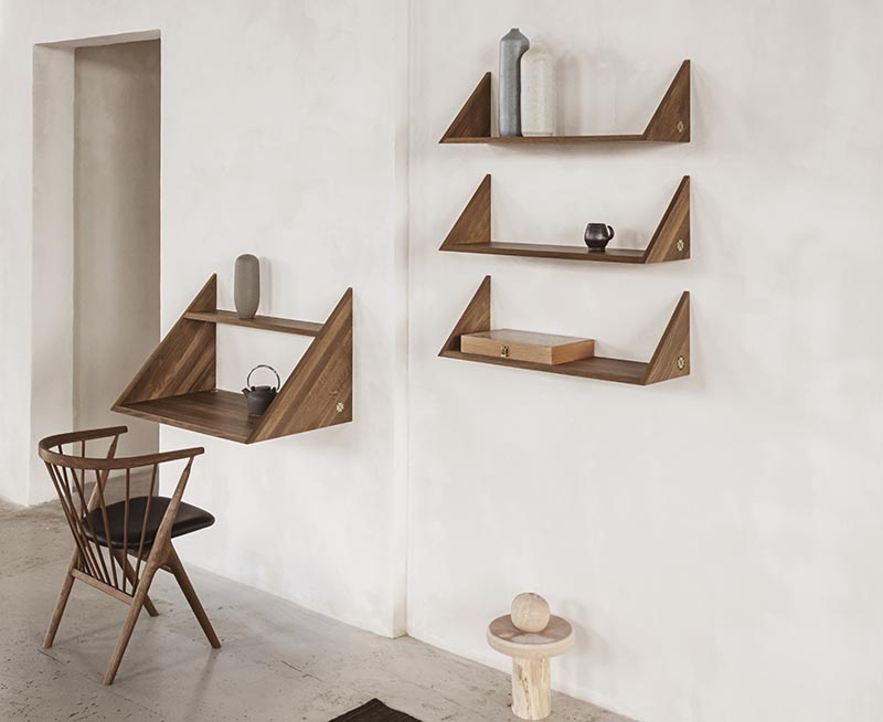 A modern wood wall desk with matching shelving.