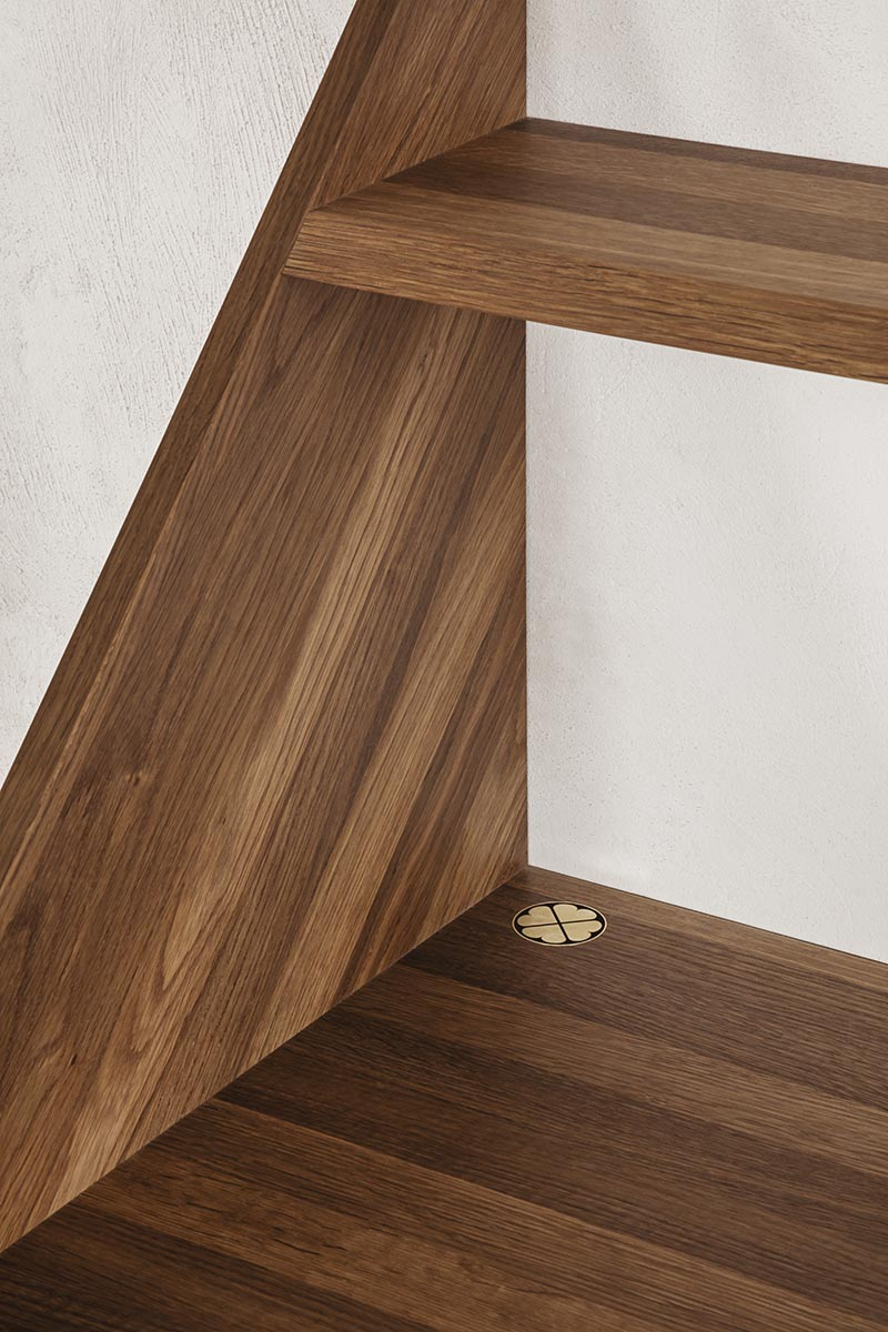 A floating wall desk made from warm wood.