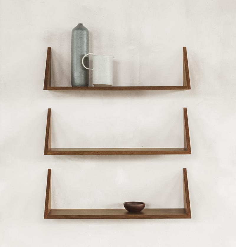 A collection of three floating wall shelves.