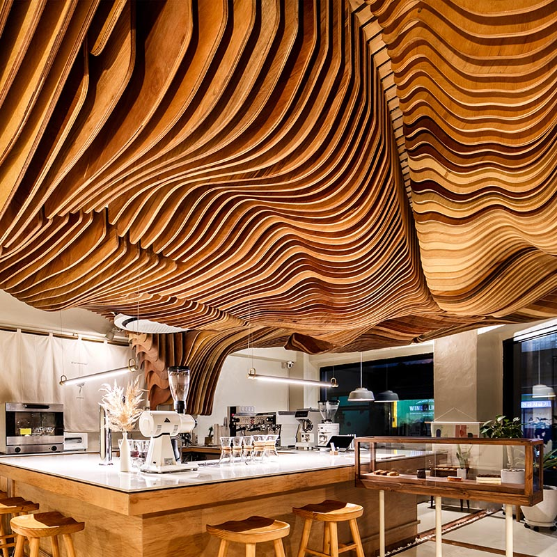 "The attractive ceiling sculpture in this cafe is called ""Shading tree"", and it starts from the preparation zone, and covers the customer area to create a unique atmosphere. #CafeDesign #SculpturalCeiling #CoffeeShop #InteriorDesign"
