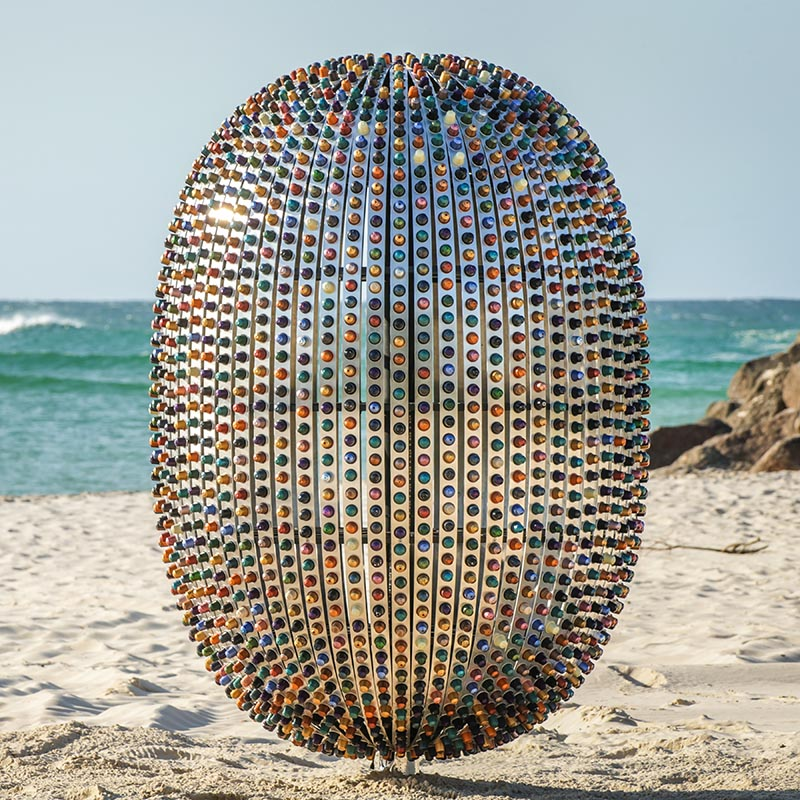 The sculpture represents the rapid multiplying of single use coffee capsules, which symbolizes human convenience and its impact on our environment. #Sculpture #Art #ModernSculpture #Design