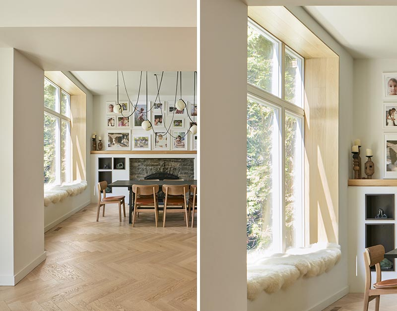 Lined with wood and cushioned with sheepskin, this modern built-in window seat looks out to the tall trees in the garden. #WindowSeat #ModernInterior #InteriorDesign