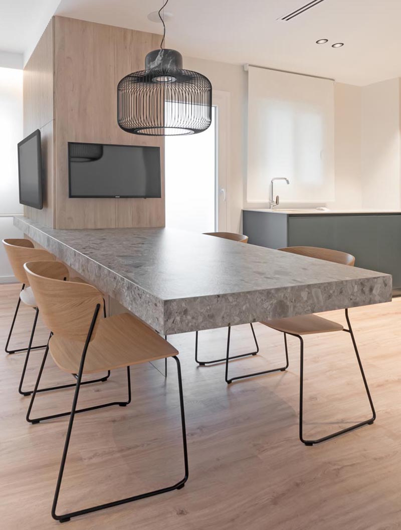 A Cantilevered Dining Table Separates